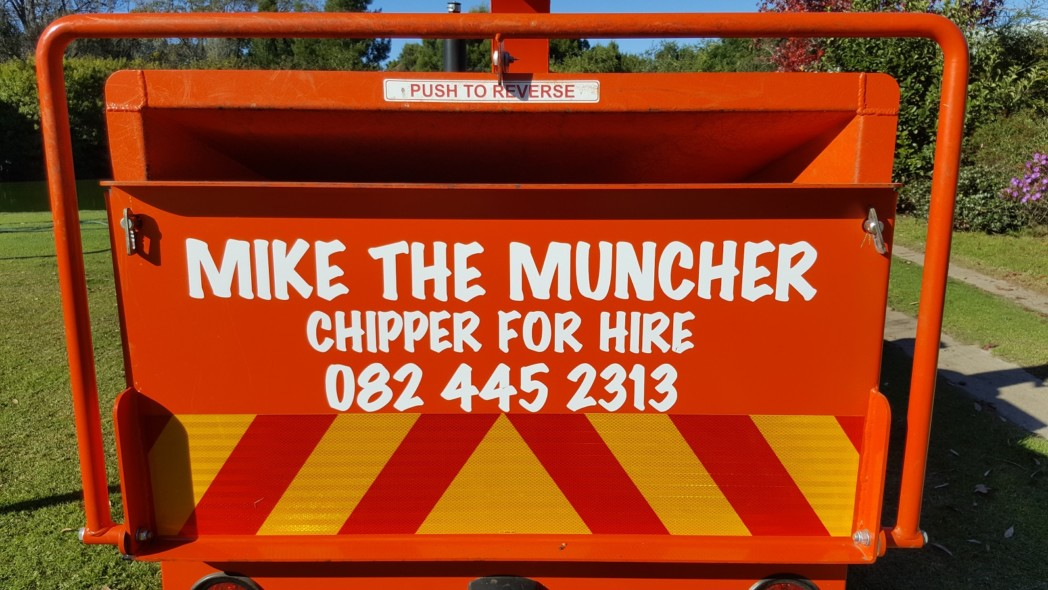 Mike Fryer from Knysna Lawns with his TOMCAT Wood Chipper Model 200 AFE chipping burnt waste and aliens to use as mulch (3)