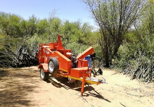 A TOMCAT 150 Screen Chipper making Bos-Tot-Kos in the South of Namibia from Prosopis trees.